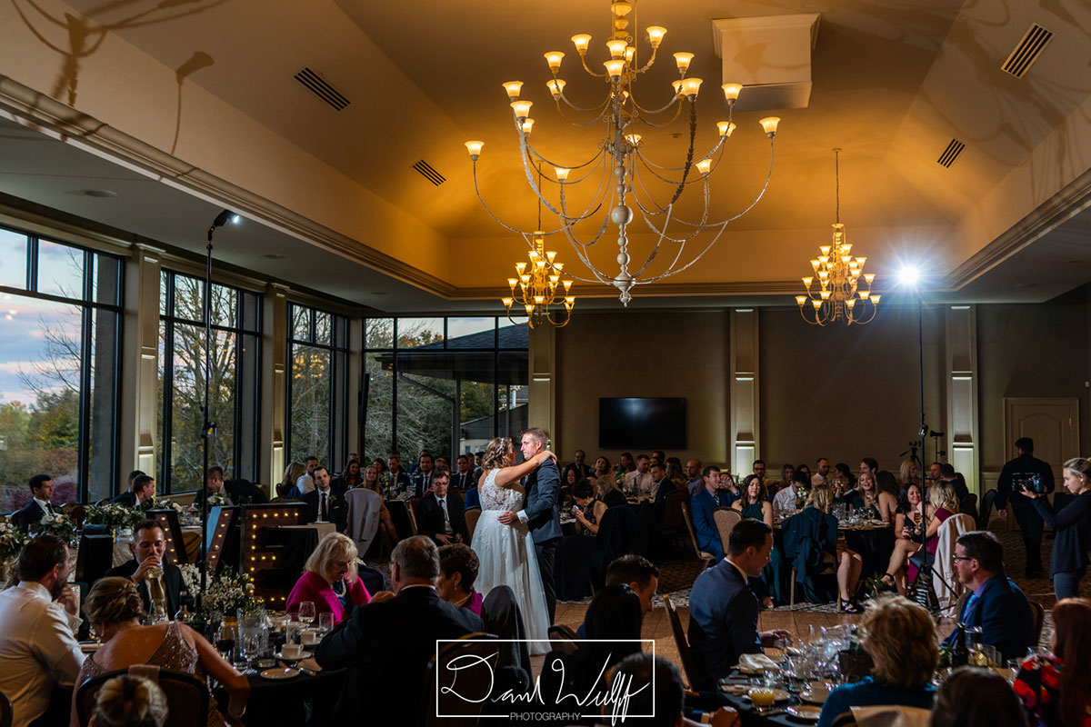 Dancing couple at a wedding reception at Crosswinds in Burlington