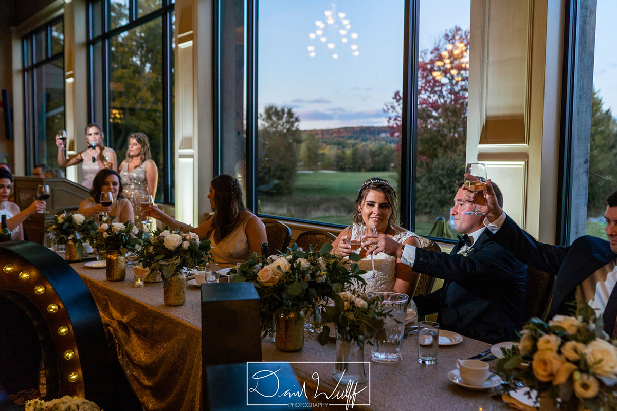 Wedding couple toast at Crosswinds reception in Burlington