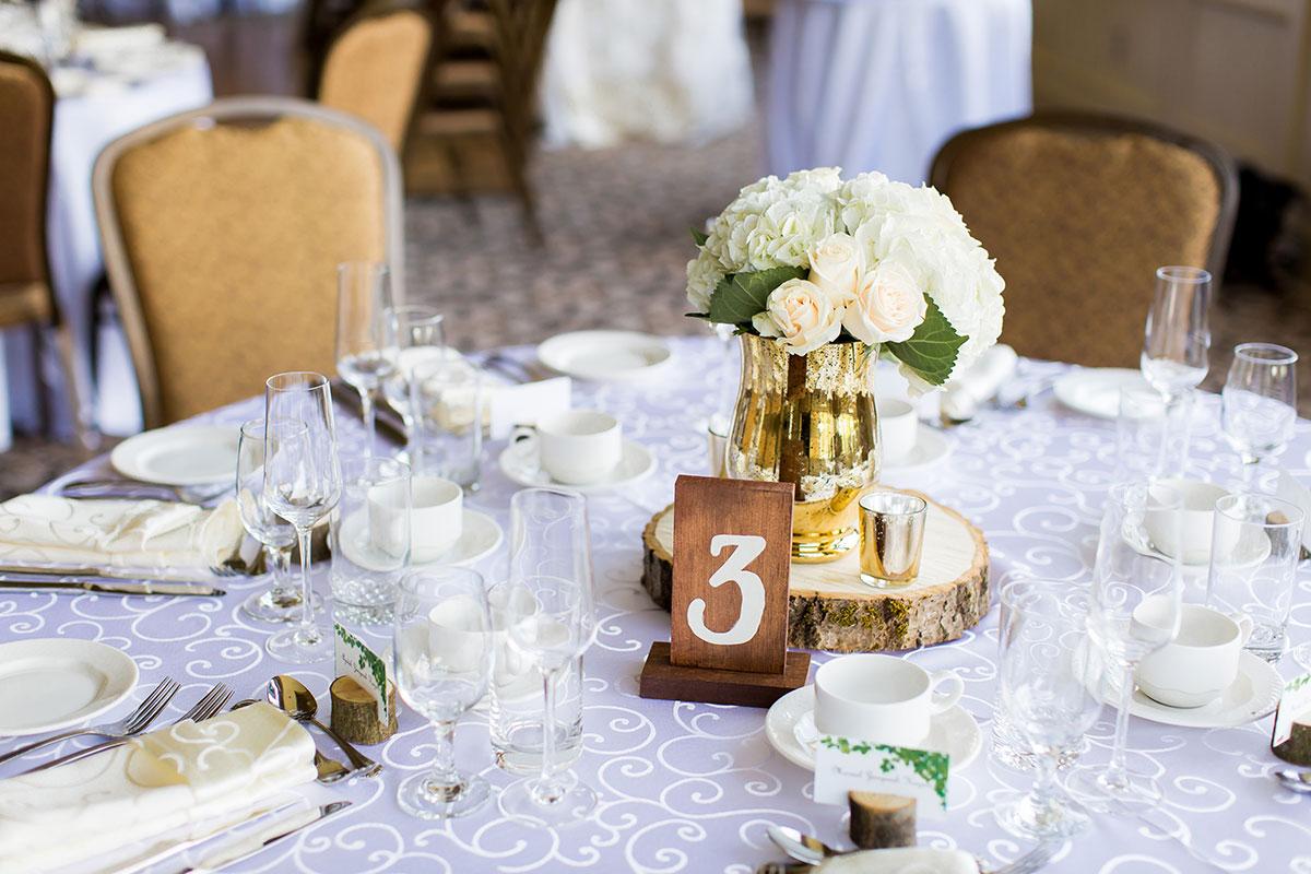 China, glassware and wedding table arrangement at Crosswinds wedding reception in Burlington