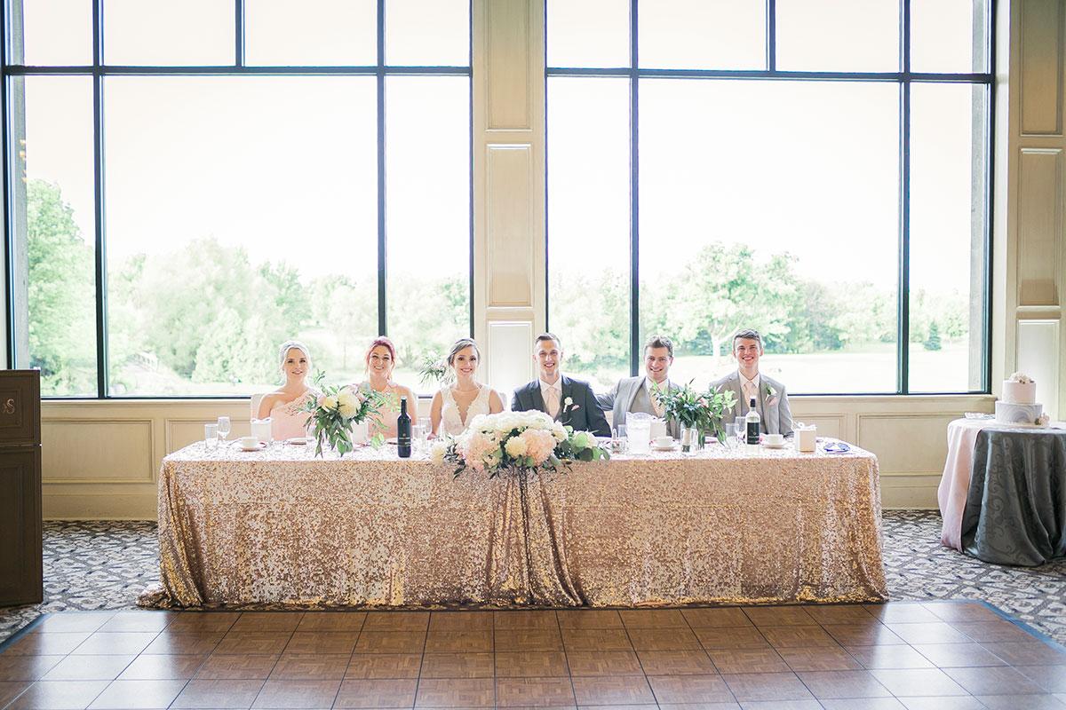 Head table and wedding party at Crosswinds wedding reception Burlington