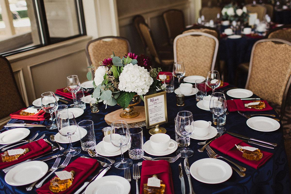 Wedding table arrangement and place settings at Crosswinds wedding reception Burlington