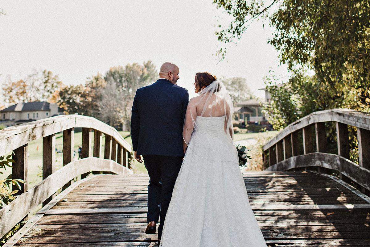 Crosswinds Burlington wedding bridge and couple
