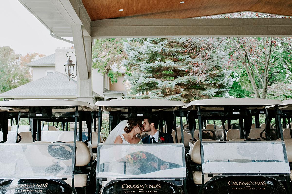 Golf cart kissing couple at Crosswinds Burlington wedding photos